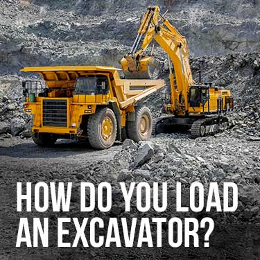 how do you load an excavator
