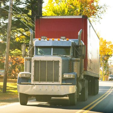 Shipping freight from Maine to California red blue semi truck