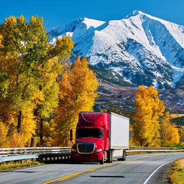 shipping freight from Maine to California red semi truck on highway
