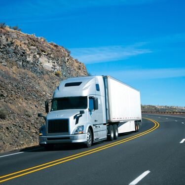 Shipping Freight from Maine to Florida Gray Semi Truck on Highway
