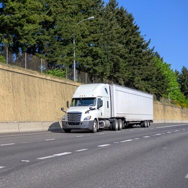 Shipping Freight from Maine to Florida White Semi Truck on Highway