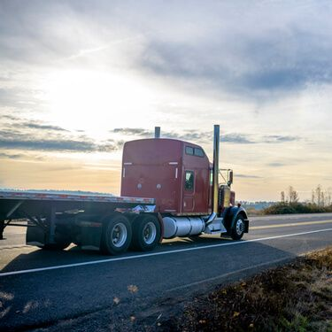 Red Flatbed Carrier on Highway