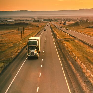Shipping Freight From Wyoming Green Semi Truckload on highway