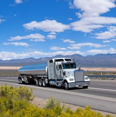 Hazmat Carrier truckload White Semi Truck