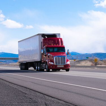 Red Semi on highway Shipping Freight from Wyoming to Florida