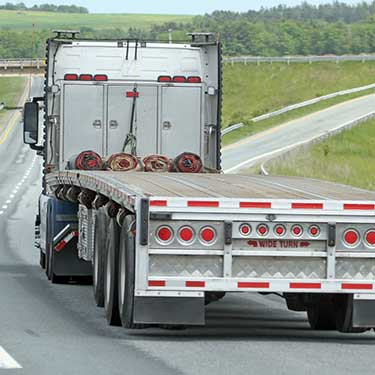 Freight Shipping from Michigan Flatbed Semi Truck on the Highway