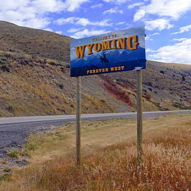 Truckload Shipping Freight From Wyoming to California Highway Sign