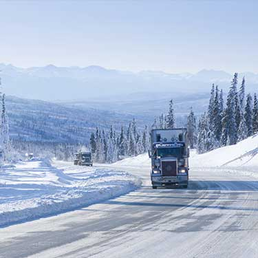 Shipping from Alaska to California Semi Truck on Alaska Snowy Highway